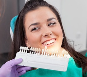 A woman smiling at a cosmetic dentist in Bloomfield Hills.