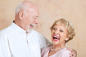 older couple smiling and hugging