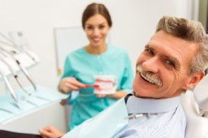 Smiling patient with dentures