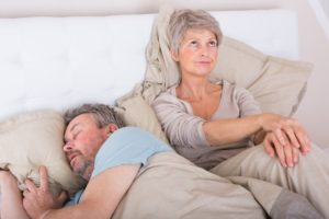 woman upset with man snoring loudly