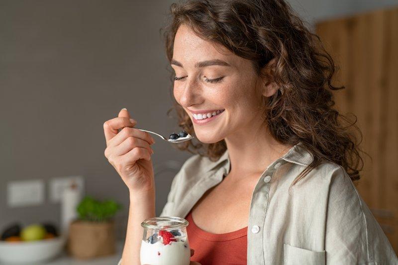 woman eating jar of yogurt in Bloomfield Hills